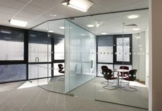 Define open space without sacrificing openness by having Giant Glass & Mirror design a custom frameless glass partition for your office or home