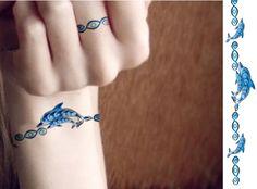 Dolphin Tattoo Idea - I like the same pattern used on a finger and wrist