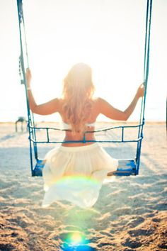 Sunrise or sunset, I want to feel the tranquility that this girl on the swing feels at the beach!  photo via tumblr