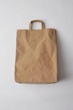 1b55d7c81816 Acne Studios Baker Brown 1500x 001 Cos Bags