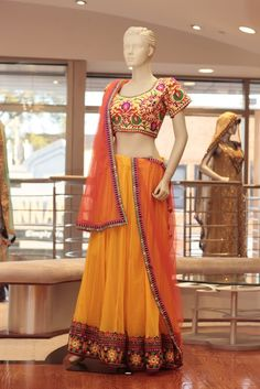 Embroidery: Thread work. Fabric: Net skirt, Net Dupatta, and Raw Silk Blouse. For more information please contact sales@sahil.com or visit us www.sahil.com