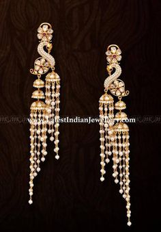 The peacock design twin jhumka hangings from Mangatrai with long pearl tassel drops. Adorned with uncut polki diamonds and round cut diamonds Diamond Earrings Indian, Gold Jhumka Earrings, Indian Jewelry Earrings, Gold Chandelier Earrings, Gold Earrings Designs, Indian Wedding Jewelry, Necklace Designs, Bridal Jewelry, Peacock Earrings