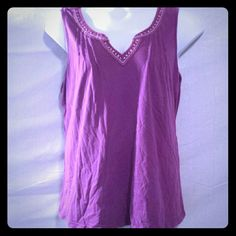 Size 2x Purple Studded Tank Top This is a very pretty tank top that is solid purple, and has light purple, red and orange designed stitching around the collar and down the v-neck.  This top also has shiny studs in between the cross stitches. #plussize #size2x #tanktop #studded Basic Edition Tops Tank Tops