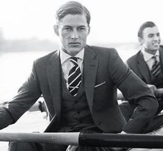 Old school way to wear a classic repp-striped tie: with 3-piece suit and silver tie bar.