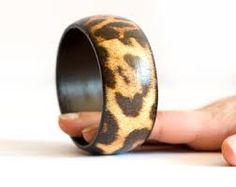 HERE'S ANOTHER ANIMAL PRINT BURNED ONTO A WOOD BRACELET.