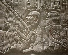 Egyptian wall art – blind harpist. Limestone scene from the Tomb Chapel of Paätenemheb, Sakkara. 1333-1307 B.C. Museum van Oudheden, Leiden