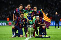 (L-R) Douglas, Daniel Alves, Adriano; Rafinha and Neymar of Barcelona celebrate with the trophy after the UEFA Champions League Final between Juventus and FC Barcelona at Olympiastadion on June 6, 2015 in Berlin, Germany.