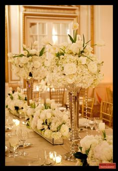 Stunning Image Of Wedding Table Decoration With White And Gold Table Centerpiece : Amusing White Wedding Design And Decoration Using Round Tapered Very Tall Flower Vase Including White Flower White And Gold Table Centerpiece And Vintage White Wood Wedding Chairs