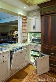 The creamy cabinetry in this kitchen opens to reveal a plethora of storage options beyond basic shelves. #housetrends