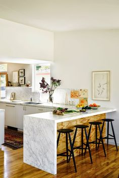 Modern Vintage Style- contrast of plywood and marble makes for a stunning dining counter.