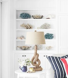 Nothing's worse than precious accessories that try too hard. Don't line items up like good little soldiers - note how some of the shells and faux coral sit diagonally. | Every room needs an exclamation point. The goal is to track down a conversation piece that doesn't hog the spotlight. This knotted-rope lamp from Pottery Barn fits the bill: Its sculptural shape draws your eye even as the neutral hue and texture recede.