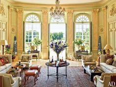 Timothy Corrigan's Spectacular French Château - The Grand Salon overlooks the château's gardens, which were restored by the French government and are open to the public six times a year; fluted pilasters frame the doors and windows, and the George Smith armchairs are upholstered in a Schumacher linen.