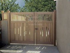 """2/3 - 1/3 gate by Charles Prowell. driveway gates $4,876/pair for 10' driveway on an incline, or $7208 for 12"""" driveway."""