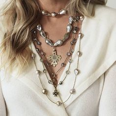 Designed and handcrafted in Santa Fe, the Baroque Gray Briolette Necklace is singular and unique. The artist layers a collage of treasures, including    freshwater pearls and vintage African metal spacers, with the addition of a bronze Old World cross. The sophisticated interplay of old and new, and of    nature and glamour, exudes bohemian flair.                Designed and handmade in Santa Fe                    Crafted of freshwater pearls and vintage African metal spacers             ...