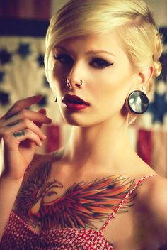 Beautiful chest tattoo. (I love her hair and makeup too)