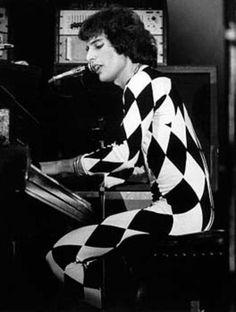 Freddie Mercury singing with piano