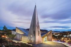 Built by Reiulf Ramstad Arkitekter in Knarvik, Norway with date 2014. Images by Hundven-Clements Photography. The new Community Church in Knarvik, located on the scenic west-coast of Norway north of Bergen, is built on a privil...