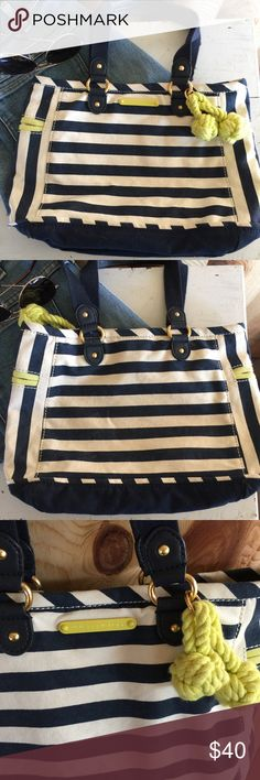 """⚓️/juicy couture/⚓️ striped canvas handbag /purse ⚓️juicy couture ⚓️nautical summer-style handbag. Cute Navy blue and white striped canvas with touches of neon chartreuse. Leather and canvas handles, magnetic closure snaps securely shut. Lined in pink and white striped cotton- zippered pocket. handful of very minor marks, I will upload an extra listing with more photos upon request! Thank you! 13"""" by 8"""", handles 8"""" drop . Juicy Couture Bags Satchels"""