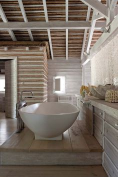 This summer home in Portugal is gorgeous!   (bath pictured) Interior designer and artist Vera Iachia.
