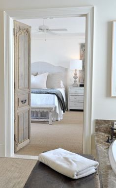 101401429084285045 love the finish on the antique french doors plus the padded headboard and gray and white palate.