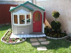 I am past the time of my life for playhouses in my backyard, but this was so cute, I had to pin it! What a great idea for making the playhouse blend into the yard decor.
