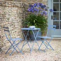 Metal Bistro Table and Chair Set from The Farthing: https://thefarthing.co.uk/products/metal-bistro-set-of-table-two-chairs-in-pastel-blue