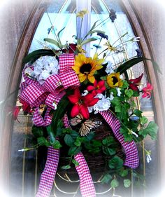 "Vine Basket.... Use on Door or wall...Full of color!  Whites, sunflowers, geraniums, and butterfly...measures 24"" in height and 18"" wide.....$26.99  http://www.primitivehomedecorandmore.com/floral-wreaths.html"