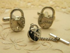 Vintage pad lock cuff links and tie tack silver tone.