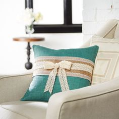 Design your very own throw pillow embellished with burlap and lace ribbon. A stylish addition to...