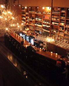 wine bar interior design ideas have a light fixture made out of antlers - Commercial Bar Design Ideas