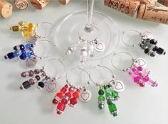 Wine Charm Favors, Bridal Shower Favors, Wedding Favors, Love/Heart Bachelorette Party Accessories, Handmade by LasmasCreations. by LasmasCreations on Etsy Wine Favors, Wine Bottle Charms, Wine Cork Projects, Wine Craft, Wedding Shower Favors, Wine Tags, Wine Decor, Painted Wine Glasses, Wine Gifts