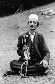 Portrait of Dule Bey Allemani, a tribal chief from Albania, holding a sten gun at Lure during the second SOE mission to Albania, July 1944.