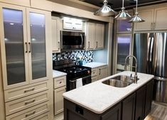Two tone kitchen; Beach front cabniets and chelsea grey island. Customize the features on your own Luxe luxury 5th wheel! Fifth Wheel Living, Luxury Fifth Wheel, Gray Island, Chelsea Gray, Two Tone Kitchen, Luxury Rv, 5th Wheels, Rv Living, Kitchen Cabinets