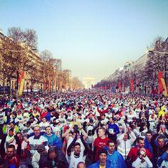 Love this shot of the Start of Paris Marathon 2013. Coutesy of Marathon de Paris.