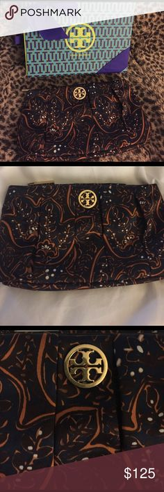 Tory Burch navy print clutch new Brand new never worn Tory Burch navy print satin clutch bag. Comes with box shown in pictures. Gold and navy print. No tears or stains and perfect condition interior as shown in pictures. 10 across by 5.5 height. Tory Burch Bags Clutches & Wristlets