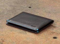 I'd love to have one of these in the cocoa color, looks like a perfect front pocket wallet.