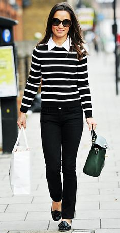 """Opting for a black-and-white nautical-inspired look, Pippa Middleton donned a pair of Goldsign """"Misfit"""" slim leg jeans, which you can get for 218 on saksfifthavenue.com. She topped the trousers with the striped Alice + Olivia Shellen Mock Collar sweater, available for 275, also on saksfifthavenue.com. Also find her hunter green bag, the Post Street Little Nadine by Kate Spade New York for 428 at katespade.com."""