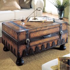 Features:  -Laminated old world map surface.  -Convenient center storage drawer.  Product Type: -Coffee table trunks.  Finish: -Old World Map.  Hardware Finish: -Brown leather, antique brass.  Materia