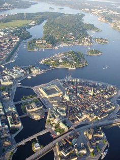 Stockholm by air. Below: The Old Town. The large visible square building is the Royal Palace. Sweden Stockholm, Visit Stockholm, Kingdom Of Sweden, Visit Sweden, Scandinavian Countries, Sweden Travel, Belle Villa, Most Beautiful Cities, Travel Images
