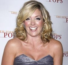 Jane Krakowskis curly hair with side-swept bangs