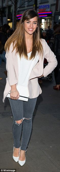 Gorgeous: Georgia opted for a smart casual look in a blushing pink blazer, white blouse and ripped jeans