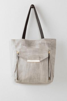 """Carry your essentials in style with the Brookshire Zip Front Tote! This faux leather bag features a large front pocket with zipper details and a flap closure. Includes a large inner pouch with an interior zipper pocket and two open pockets. Pair with a casual top and sandals for the perfect weekend look. <br><br>    -16.5"""" width x 15"""" height x 4"""" depth<br> -12.5"""" width x 12"""" height x 3"""" depth (inner bag)<br>  -12"""" handle drop<br> -Imported <br>"""