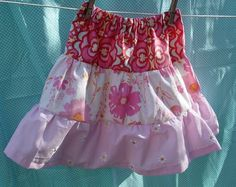Tiered skirts are made by stacking three (or more) panels of fabric. Each panel is 1.5 times wider than the one above it. They are all app...