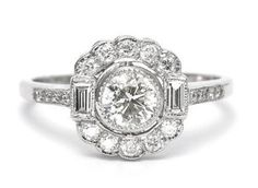 It's a lovely vintage style diamond daisy cluster ring showing off a sublime combination of brilliant and baguette cut diamonds. The ring has a combined diamond weight of 1.15ct. The central transitional cut diamond is set in a rub over setting and weighs 0.60ct. The central diamond has been out of its setting and weighed and its an absolutely lovely stone.   Genuinely any excuse, i'm sure you'll agree with me.  #daisydiamonds #diamond #cluster