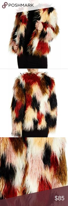 NWT faux fur jacket Perfect for fall and cruelty free! This jacket is so fun! Faux fur in black, cream, red, brown and yellow, lined, hook and eye closure, crew neck. Romeo & Juliet Couture Jackets & Coats