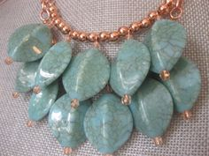 Turquoise Beaded Bib Necklace with Rose Gold Beads & Chain via Etsy.