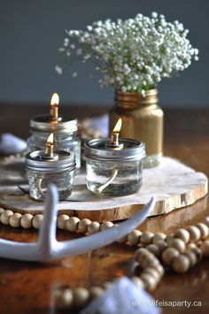 DIY Mason Jar Oil Lamps: Simple to make and so beautiful. Perfect for a party, wedding centerpiece, or just in your home.