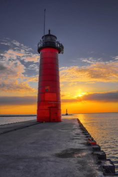 © Dale Kauzlaric Photography 2015 - On this morning, the sun is starting to peek through the clouds at the Kenosha Lighthouse in Kenosha, Wisconsin. This lighthouse is now privately owned by an artist, as a studio.
