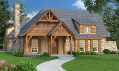 <ul><li>This rustic cottage house plan has a stone and shingle exterior and stout timbers supporting the covered porch and entry. A shed dormer adds to the curb appeal.</li><li>Inside, the living room has a stone-faced fireplace, 10' high tray ceiling and there is even a wood storage box and lots of built-ins. The dining and kitchen are open and airy with an eating bar in the kitchen.</li><li>The master suite has a beamed cathedral ceiling, sitting area, large walk-in closet and a plush bath…