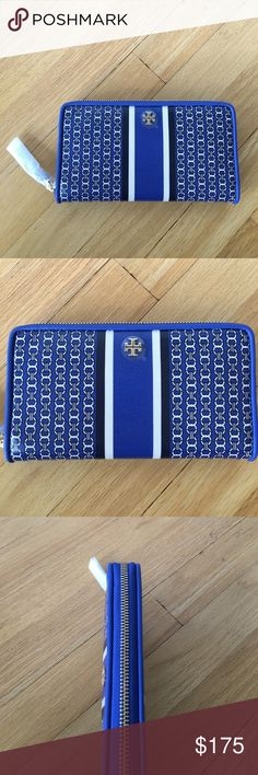 """New Tory Burch Authentic Gemini Link Zip Wallet Jewel Blue. Made of water-resistant coated canvas and punctuated by a bold racing stripe, it has multiple pockets and a classic long shape that fits all full-length bills without folding. It's a great everyday organizer — and a perfect gift.  Height: 4.3"""" (10.8 cm) Length: 7.65"""" (19.2 cm) Tory Burch Bags Wallets"""